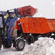 Механизированная уборка снега экскаватором